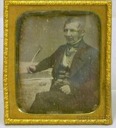 Daguerreotype Portrait of a Seated Gentleman with Quill Pen.