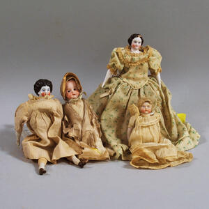 Four Small Antique Dolls