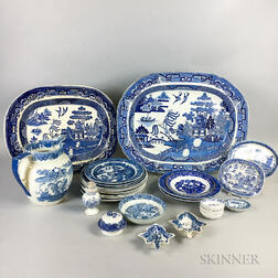 "Twenty-seven Pieces of Staffordshire ""Blue Willow"" Transfer-decorated Tableware.     Estimate $200-250"