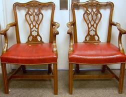 Pair of Chippendale-style Red Leather Upholstered Carved Cherry Armchairs.