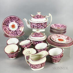 Thirty-two Pieces of Pink Lustre Ceramic Teaware.     Estimate $150-250