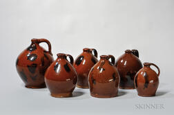 Six Manganese-decorated Redware Jugs