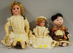 Two German Bisque Head Dolls and a Composition Japanese Baby