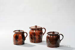 Three Small Redware Covered Pitchers