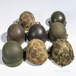 Eight U.S. M1 Helmets