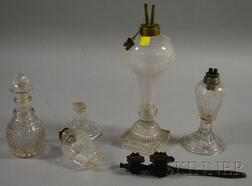Three Colorless Glass Fluid Burning Lamps, a Decanter, and a Tramp Art Carved   Mahogany Rattle