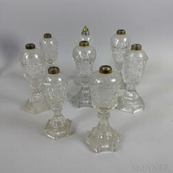Eight Sandwich-type Blown Colorless Glass Fluid Lamps