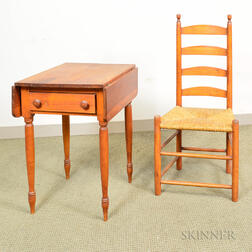 Federal Cherry One-drawer Drop-leaf Table and a Ladder-back Side Chair.     Estimate $150-250
