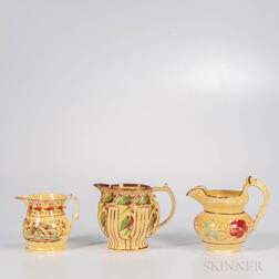 Three Yellow-glazed Staffordshire Jugs