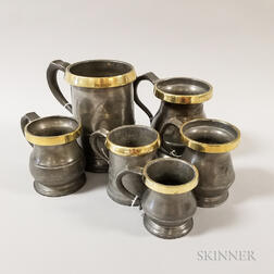 Six Brass-rimmed Pewter Measures