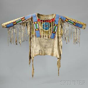Sold for: $165,000 - Blackfoot Beaded and Painted Antelope Hide Shirt