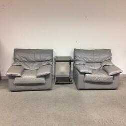 Pair of Modern Gray Leather-upholstered Chairs and a Modern Table.     Estimate $20-200