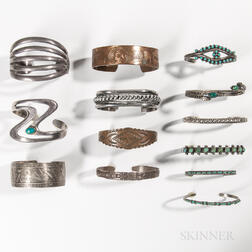 Twelve Southwest and Northwest Coast Silver Band Bracelets