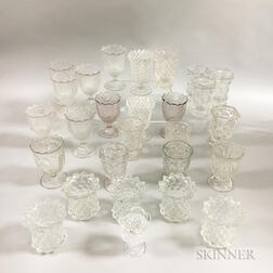 Twenty-seven Colorless Pressed Glass Spoon and Spill Holders.     Estimate $200-300