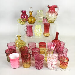 Twenty-seven Pieces of Mostly Cranberry and Amberina Glass Tableware.     Estimate $200-300
