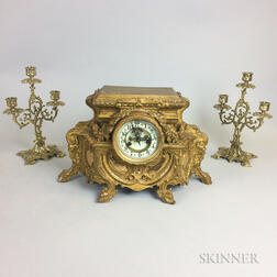 Rococo-style Brass Mantel Clock and a Pair of Three-light Candelabra