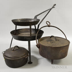 Two Cast Iron Covered Kettles and Two Tripod Pans.     Estimate $200-300