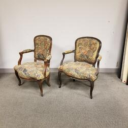 Two Louis XV Needlepoint-upholstered and Carved Walnut Fauteuils