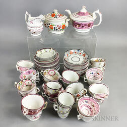 Approximately Sixty-two Pieces of Floral-decorated Pink Lustre Teaware.     Estimate $200-300
