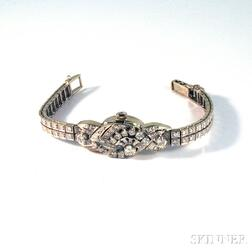 Lady's 14kt White Gold and Diamond Covered Bracelet Wristwatch