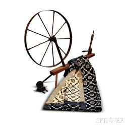 Turned Spinning Wheel and a Blue and White Woven Coverlet.     Estimate $200-250