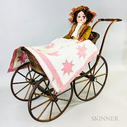 German Bisque Socket Head Doll, Wicker Doll Carriage, and an Appliqued Cotton Doll Quilt.     Estimate $200-300