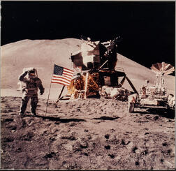 Apollo 15, Astronaut James B. Irwin Gives a Military Salute While Standing Beside the Deployed United States Flag (NASA AS15-88-1...