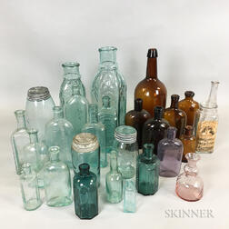 Twenty-six Colored Blown Glass Patent Medicine Bottles, Jars, and Flasks