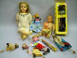 Four Assorted Celluloid Dolls