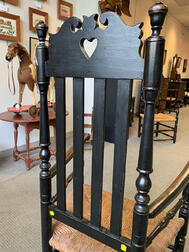 Black-painted Bannister-back Heart and Crown Armchair