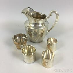 Sterling Silver Water Pitcher, Three Sterling Silver Cups, and a Sterling Silver Flower Pot