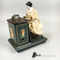 Mechanical China Shoulder Head Doll at a Sewing Machine