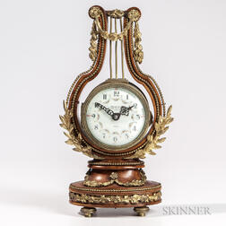 French Gilt-bronze-mounted Burlwood Lyre-form Clock