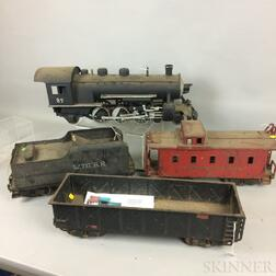 Large Scale Buddy L. Pressed Steel Engine, Tender, Car, Caboose, and Tracks.     Estimate $400-600