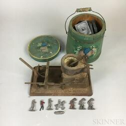 Small Group of Lead Soldiers, Molds, a Melting Pot, and a Miniature Paint-decorated Bucket.     Estimate $100-200