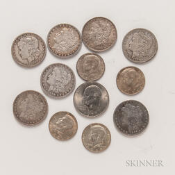 Seven Morgan Dollars, Four Silver-clad Kennedy Half Dollars, and a 1971 Eisenhower Dollar.     Estimate $100-200