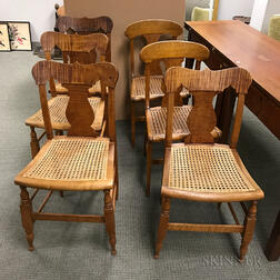 Six Tiger Maple Caned-seat Side Chairs.     Estimate $300-400