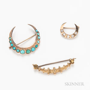 Three Gold Crescent Brooches