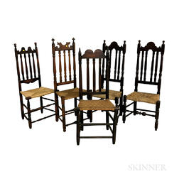 Five Black-painted Banister-back Side Chairs.     Estimate $250-350