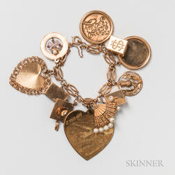14kt Gold Charm Bracelet with 14kt Gold and Gold-plated Figural Charms