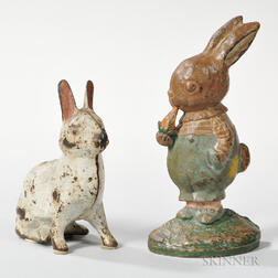 Two Cast Iron and Paint-decorated Rabbit Doorstops including Peter Rabbit by Hubley