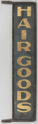 """Black-painted and Gilt-lettered """"HAIR GOODS"""" Trade Sign"""