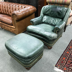 Modern Green Leather-upholstered Easy Chair and Ottoman.     Estimate $150-250