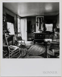 Walker Evans (American, 1903-1975)       Kodak #1 Camera in Living Room with Stove, New England