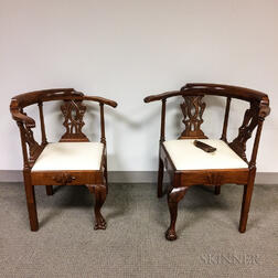Pair of Chippendale-style Carved Mahogany Roundabout Chairs