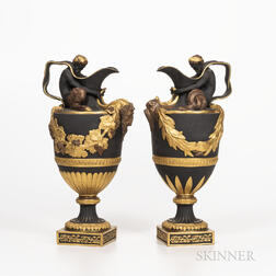Pair of Wedgwood Gilded and Bronzed Black Basalt Wine and Water Ewers