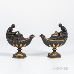 Two Wedgwood Gilded and Bronzed Black Basalt Oil Lamps and Covers