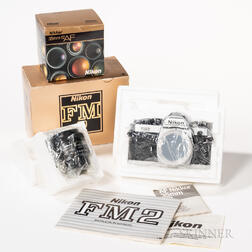New-in-box Nikon FM2 Body and 35mm Lens.