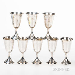Set of Eight Cartier Sterling Silver Wine Goblets.     Estimate $1,000-1,500